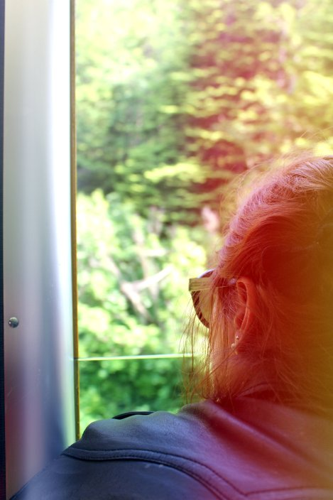 Jess looking out the train. Definitely called for the light leak.